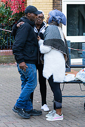 Lorna, the victim's aunt and a friend comfort brother Marvin following the murder on October 17th of Ian Tomlin, 46, at a high-rise Doddington Estate on Charlotte Despard Avenue in Battersea, South London . Battersea, London, October 18 2018.