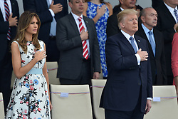 US President Donald Trump and First Lady Melania Trump attend the annual Bastille Day military parade on the Champs-Elysees avenue in Paris on July 14, 2017. Photo by Lionel Hahn/ABACAPRESS.com