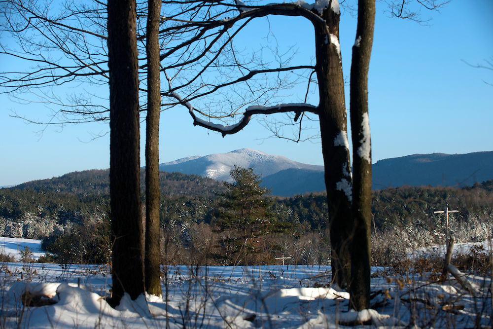 Cold winter temperatures make for clear blue skies over the Green Mountains on a January day in Brandon, Vermont.
