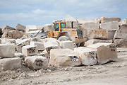 Heavy machinery at work in a stone quarry on the Isle of Portland, Dorset, England, UK