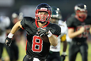 Linn-Mar's Andy Henry (8) returns the opening kickoff for a touchdown during the game between Cedar Rapids Kennedy and Linn-Mar at Linn-Mar Stadium in Marion on Friday evening, September 2, 2011. It was 35-7 Linn-Mar at halftime.