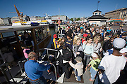Kauppatori (Market Square). School kids boarding shuttle boat to the zoo.