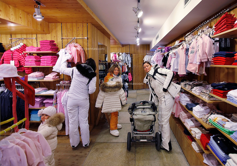 Italy, Madonna di Campiglio, shopping for tiny , cute skiers