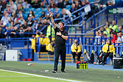 Daniel Stendel of Barnsley F.C. gives a thumbs up to  Barnsley Fans during the EFL Sky Bet Championship match between Sheffield Wednesday and Barnsley at Hillsborough, Sheffield, England on 10 August 2019.