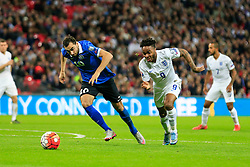 Raheem Sterling of England puts Sergei Zenjov of Estonia under pressure - Mandatory byline: Jason Brown/JMP - 07966 386802 - 09/10/2015- FOOTBALL - Wembley Stadium - London, England - England v Estonia - Euro 2016 Qualifying - Group E