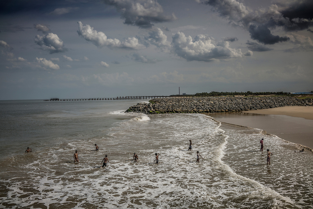 Boys swim in the sea as Tiruchchepuram, prepares for the Ganesh Chaturthi Festival. Tamil Nadu, India.