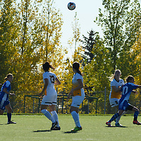 3rd year midfielder Nikita Senko (9) of the Regina Cougars keeps her eye on the ball during the women's soccer home game on October 1 at U of R Field. Credit: Arthur Ward/Arthur Images