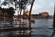 Paris . Flooding . The Seine river at the quay de la Tournelle , in the distance Notre dame cathedral