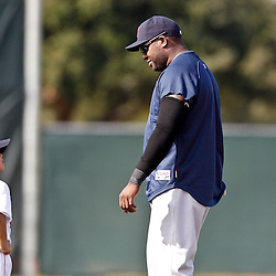 February 17, 2011; Fort Myers, FL, USA; Boston Red Sox first baseman David Ortiz (34) with his son D'Angelo Ortiz during spring training at the Player Development Complex.  Mandatory Credit: Derick E. Hingle