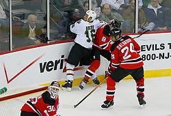 Oct 22, 2008; Newark, NJ, USA; New Jersey Devils center Dainius Zubrus (8) hits Dallas Stars center Sean Avery (16) during the second period at the Prudential Center.