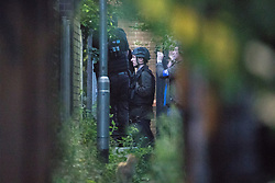 © Licensed to London News Pictures . 26/07/2017 . Oldham , UK . Hostage negotiator in an alleyway adjacent to the scene where an armed siege that began at 3.15am on Tuesday 25th July in a house on Pemberton Way in Shaw , is ongoing in to a second night . A man named locally as Marc Schofield is reported to be holding a woman hostage after earlier releasing two children . The gas supply in the area has been cut off and several neighbouring properties have been evacuated . Photo credit : Joel Goodman/LNP