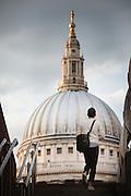 Man walking towards St Pauls Cathedral, London, England