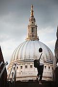Man walking towards St Pauls Cathedral, London, England