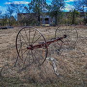Rusting farm equipment from an earlier time in Oklahoma is seen in a rural field near Blanchard, Ok.