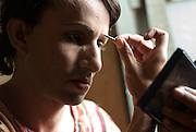 Sonya, a 32 year old Hijra prepares his make up for the evenings work on the streets of Karachi...The word Hijra is an Urdu word meaning eunuch or hermaphrodite. However, most Hijras in Pakistan are gay men who leave home to join the Hijra community as young boys where there is more acceptance. Most identify themselves as more feminine then masculine and dress and act accordingly...Although tolerated in a country where homosexuality is against the law, Hijras are largely ostracised from society. They are often denied work opportunities, rejected by most families, lack formal education and live in poorer areas of the city...They share similarities with the more famous Hijra communities in the Indian subcontinent and Bangladesh. In a continent where great emphasis is placed on one's ability to have children, those who are unfortunate not to be able to conceive children are not considered a true man or woman. Life for many Hijras in Pakistan consists of begging for alms (Zakat) in the more prosperous areas of the city as well as slums in addition to receiving alms when bestowing blessings on male babies and at weddings....Most Hijras dress as women, and engage in activities such as dancing and entertaining in public - activities that would be considered inappropriate for women of the subcontinent. Some members of the community engage in prostitution. .