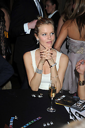EVA HERZIGOVA at a party to celebrate the launch of Hollywood Domino - a brand new board game, held at Mosimann's 11b West Halkin Street, London on 7th November 2008.  The evening was in aid of Charlize Theron's Africa Outreach Project.