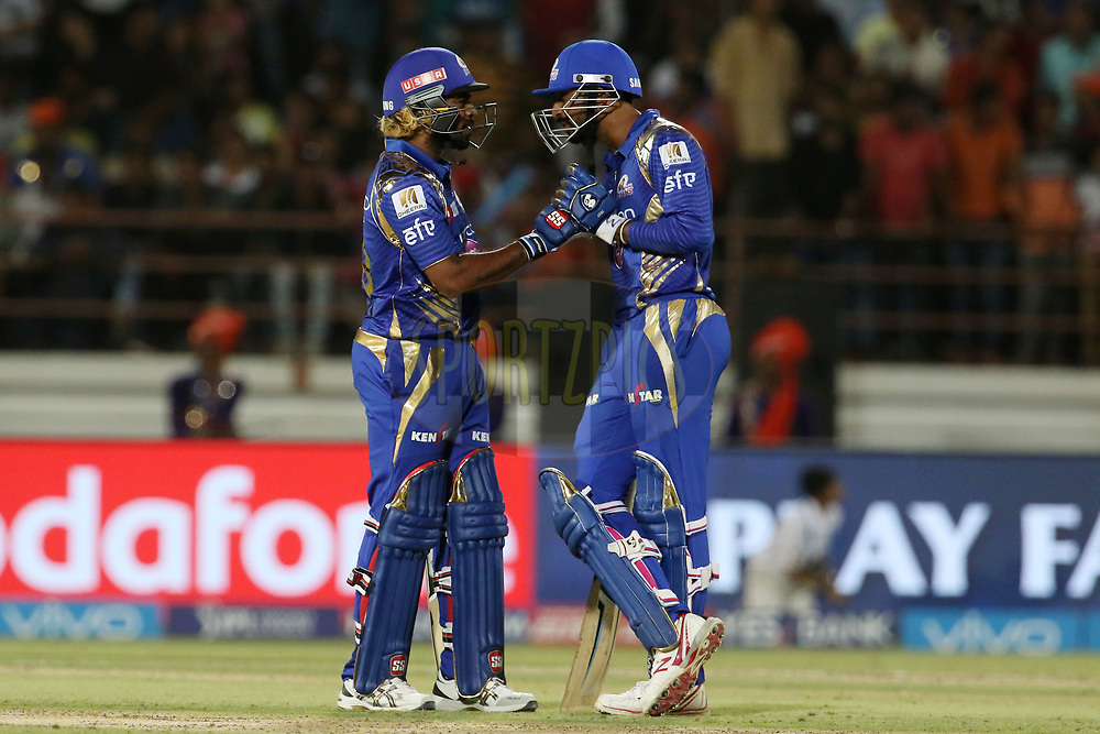 Lasith Malinga of the Mumbai Indians and Krunal Pandya of the Mumbai Indians speaks during match 35 of the Vivo 2017 Indian Premier League between the Gujarat Lions and the Mumbai Indians  held at the Saurashtra Cricket Association Stadium in Rajkot, India on the 29th April 2017<br /> <br /> Photo by Vipin Pawar - Sportzpics - IPL
