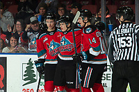 KELOWNA, BC - NOVEMBER 1:  Sean Comrie #3 and Elias Carmichael #14 congratulate Pavel Novak #11 of the Kelowna Rockets on a first period goal against the Prince George Cougars at Prospera Place on November 1, 2019 in Kelowna, Canada. (Photo by Marissa Baecker/Shoot the Breeze)