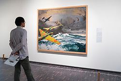 Man looking at painting Transoceanic Bombing by Toraji  Ishikawa at National Museum of  Modern Art  in Tokyo