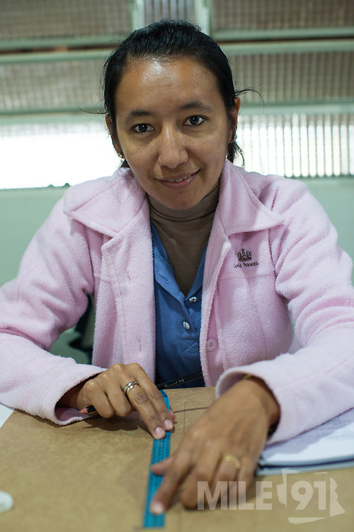 """María taking part in a textile workshop.<br /> <br /> Maria is originally from Paraguay and has been in Brazil for six years. <br /> <br /> She is studying, """"for the chance for a better tomorrow, to be someone in life and provide more for our children. """""""