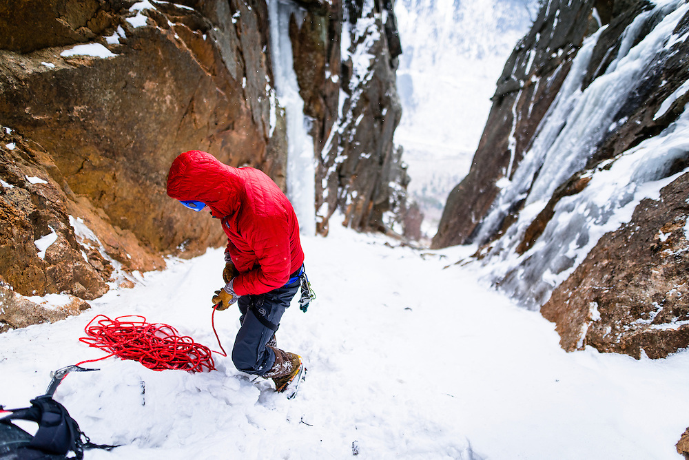 AMC Ice Climbing student tying into the rope at the base of Green Mile on Mount Webster