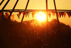 © Licensed to London News Pictures. Sunday 6th May, The sun sets on the Somerset Cider & Cheese Fayre held at the Ring O Bells in Comptin Martin, Somerset. Photo credit: Jason Bryant/LNP