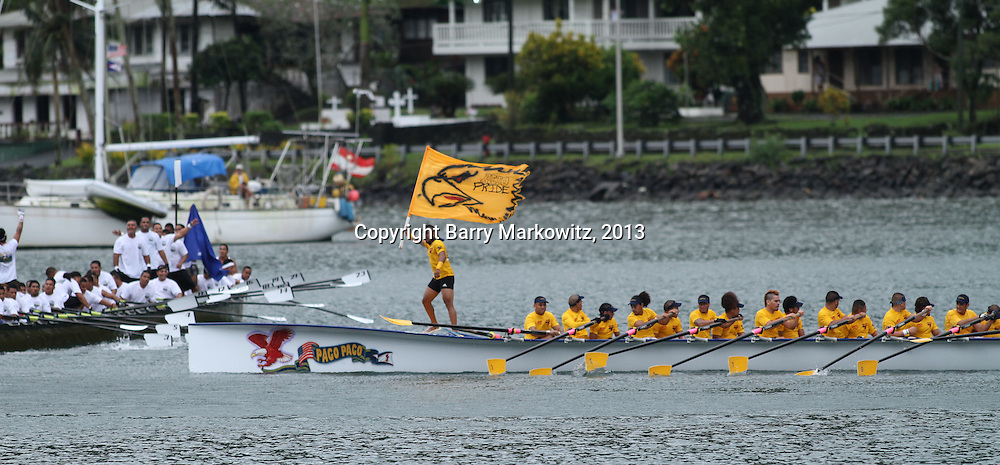 The Aeto proudly waves its colors at the finish of the American Samoa Flag Day traditional fautasi race at Pago Pago Harbor, Tutuila, American Samoa.  Photo by Barry Markowitz, 4/17/13, Courtesy Samoa Tuna Processors/Tri Marine Group