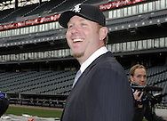CHICAGO - DECEMBER 03:  Adam Dunn of the Chicago White Sox looks on after a press conference announcing his free agent signing with on December 3, 2010 at U.S. Cellular Field in Chicago, Illinois.  (Photo by Ron Vesely)