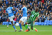 AFC Wimbledon striker Tom Elliott (9) challenges Peterborough United defender Jack Baldwin (6) during the EFL Sky Bet League 1 match between Peterborough United and AFC Wimbledon at ABAX Stadium, London Road, Peterborough, England on 22 October 2016. Photo by Stuart Butcher.