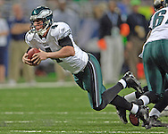 Philadelphia Eagles quarterback Mike MaMahon trips and falls down for a five yard loss in the fourth quarter agaisnt St. Louis, at the Edward Jones Dome in St. Louis, Missouri, December 18, 2005.  The Eagles beat the Rams 17-16.