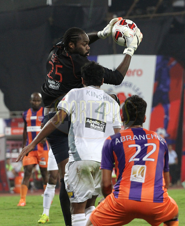 Edel Apoula Edima Bete of Atletico de Kolkata saves a goal during match 44 of the Hero Indian Super League between FC Pune City and Atletico de Kolkata FC held at the Shree Shiv Chhatrapati Sports Complex Stadium, Pune, India on the 29th November 2014.<br /> <br /> Photo by:  Vipin Pawar/ ISL/ SPORTZPICS
