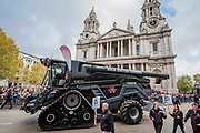 A combine harvester passes St Paul's - The new Lord Mayor (Peter Estlin, the 691st) was sworn in yesterday. To celebrate, today is the annual Lord Mayor's Show. It includes Military bands, vintage buses, Dhol drummers, a combine harvester and a giant nodding dog in the three-mile-long procession. It brings together over 7,000 people, 200 horses and 140 motor and steam-driven vehicles in an event that dates back to the 13th century. The Lord Mayor of the City of London rides in the gold State Coach.