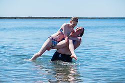 © Licensed to London News Pictures. 29/06/2018. Aberystwyth, UK. Dance Students from the local college cool down in the water after an end of term performance<br />  as, people flock to the seaside in Aberystwyth as the scorchingly hot  and very dry weather continues to dominate the UK Photo credit: Keith Morris/LNP