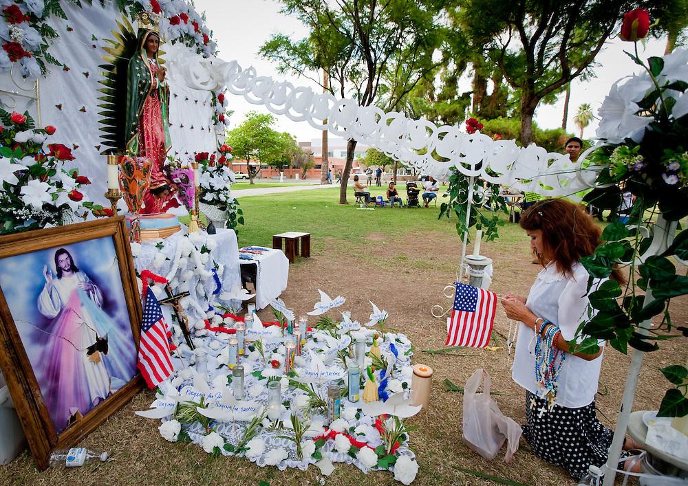 Maria Villalpando of Phoenix, age 59, prays in front of Virgin de Guadalupe.