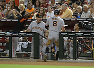 PHOENIX, AZ - JUNE 08:  Hunter Pence #8 of the San Francisco Giants is congratulated by manager Bruce Bochy #15 after scoring on a throwing error made by catcher Miguel Montero #26 of the Arizona Diamondbacks (not pictured) in the second inning at Chase Field on June 8, 2013 in Phoenix, Arizona. The Giants defeated the Diamondbacks 10-5.  (Photo by Jennifer Stewart/Getty Images) *** Local Caption *** Hunter Pence; Bruce Bochy