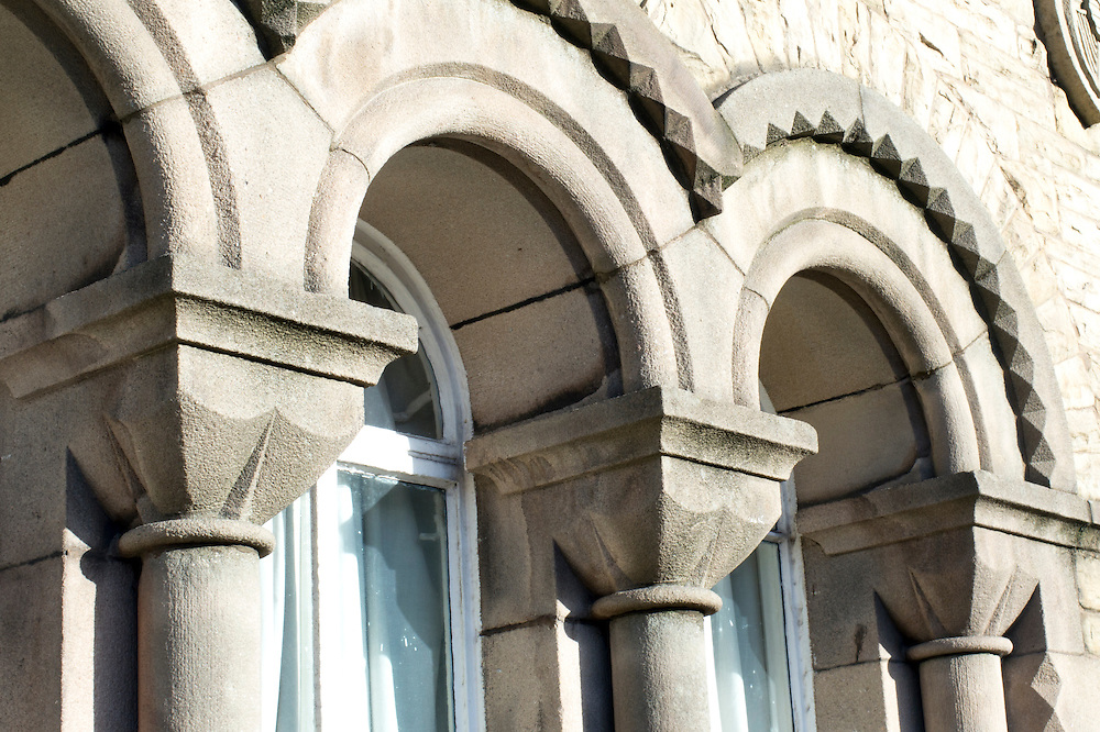 Window detail Castle Armoury, Bury, Lancashire, UK. Romanesque Revival roundheaded window detail with cushion capitals built in 1868