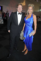 AL GOSLING and VERITY EVETTS at The Butterfly Ball in aid of the Caudwell Children Charity held in Battersea park, London on 14th May 2009.