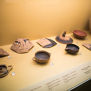Pottery from wells dating to the 7th century BC. The Stoa of Attalos is a 1950s recreation of a long pavilion that was originally built around 150 BC. It was part of the Ancient Agora (market). It now houses the Museum of the Ancient Agora, which includes clay, bronze and glass objects, sculptures, coins and inscriptions from the 7th to the 5th century BC, as well as pottery of the Byzantine period and the Turkish conquest.