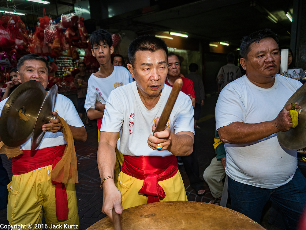 """08 FEBRUARY 2016 - BANGKOK, THAILAND: Drummers for a lion dance troupe performs in Bangkok's Chinatown district during the celebration of the Lunar New Year. Chinese New Year is also called Lunar New Year or Tet (in Vietnamese communities). This year is the """"Year of the Monkey."""" Thailand has the largest overseas Chinese population in the world; about 14 percent of Thais are of Chinese ancestry and some Chinese holidays, especially Chinese New Year, are widely celebrated in Thailand.       PHOTO BY JACK KURTZ"""