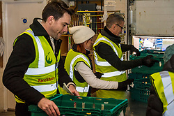 Pictured: Volunteers start packing up the donated goods<br /> <br /> Today, Communities Secretary Aileen Campbell was joined by Councillor Elena Whitham, Cosla Community Wellbeing Spokesperson, Kevin Stewart, Minister for Local Government, Housing and Planning and Jon Sparkes Chief Executive of Crisis as she visited Cyrenians' Good Food depot where she met staff at the depot and toured the facility which redistributes surplus food to not-for-profit organisations. <br /> <br /> Ger Harley | EEm 27 November 2018
