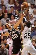 Jazz center Al Jefferson (25) pulls in a rebound over Spurs guard Manu Ginobili (20) during the second half of the NBA basketball game between the Utah Jazz and the San Antonio Spurs at Energy Solutions Arena, Wednesday, Dec. 12, 2012.