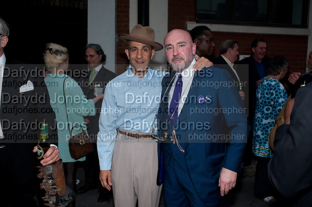 CHRISTOS TOLERA; MARK POWELL, A Celebration of Style; cool London through the Photographer's lens. Curated by Sandra Higgins. Mark Powell. Marshall St. London. 20 June 2010. -DO NOT ARCHIVE-© Copyright Photograph by Dafydd Jones. 248 Clapham Rd. London SW9 0PZ. Tel 0207 820 0771. www.dafjones.com.
