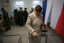 Referendum starts in Crimea. A lady gives her vote in Simferopol, . Sunday, 16th March 2014. Picture by Daniel Leal-Olivas / i-Images