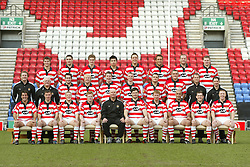 WIGAN, ENGLAND - Tuesday, January 6, 2004: Wigan Warriors' team pre-season photo-call at the JJB Stadium. (Pic by David Rawcliffe/Propaganda)..Back row: Dave Allen, Stephen Wild, Sean O'Loghlin, Harrison Hansen, Danny Sculthorpe, Craig Smith, Terry O'Connor, Danny Tickle...Middle row (l-r): Denis Betts (head coach), David Unsworth (kit man), Bob Beswick, Mick Cassidy, Martin Aspinwall, Kevin Brown, Terry Newton, Gareth Hock, Alan Tomlinson (physio), Nigel Ashley-Jones (conditioner)...Front row: Brian Carney, Mark Smith, Luke Robinson, Brett Dallas, Mike Gregory (head coach), Andy Farrell (captain), David Hodgson, Quentin Pongia, Danny Orr, Kris Radlinski.