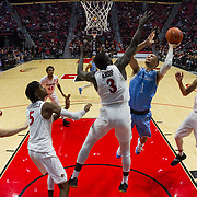 05 December 2018: San Diego State Aztecs forward Aguek Arop (3) attempts to block a shot from San Diego Toreros guard Tyler Williams (1) in the first half. The Aztecs lost to the Toreros 73-61 at Viejas Arena.