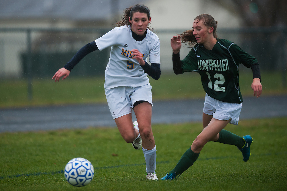 Montpelier's Lily Fournier (12) and Milton's Carlie Reen (5) battle for the ball during the girls semifinal soccer game between Montpelier and Milton at Milton High School on Wednesday afternoon October 28, 2015 in Milton, Vermont. (BRIAN JENKINS/ for the FREE PRESS)