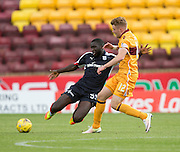 Dundee's Kevin Gomis tackles Motherwell's Chris Cadden - Motherwell v Dundee in the Ladbrokes Scottish Premiership at Fir Park, Motherwell. Photo: David Young<br />