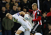 Liam Cooper of Leeds United and Sheffield United's striker Leon Clarke contest a loose ball during the EFL Sky Bet Championship match between Leeds United and Sheffield Utd at Elland Road, Leeds, England on 27 October 2017. Photo by Paul Thompson.