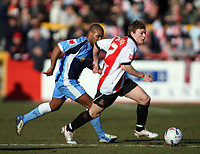 Photo: Richard Eaton.<br /> Cheltenham Town v Wycombe Wanderers. Coca Cola League 2. 04/03/2006.<br /> Brian Wilson makes a break for Cheltenham.