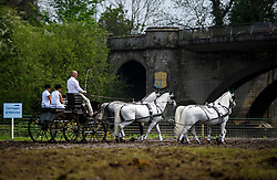 © London News Pictures. 12/05/2016. Windsor, UK. A horse drawn carriage makes it's way to competition on the first day of the 2016 Royal Windsor Horse Show, held in the grounds of Windsor Castle in Berkshire, England. The opening day of the event was cancelled due to heavy rain and waterlogged grounds. This years event is part of HRH Queen Elizabeth II's 90th birthday celebrations.  Photo credit: Ben Cawthra/LNP